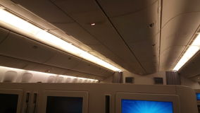 Interior of airplane with passengers on seats in Bussines class. stock video