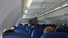 Interior of airplane with passengers on seats stock video