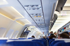 Interior of airplane with passengers on seats Royalty Free Stock Photo