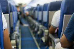 Interior of airplane with passengers on seats waiting to taik of Stock Photo