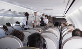 Interior of airplane with passengers Stock Image