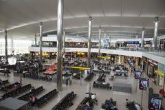 Interior of airport terminal building Stock Photos
