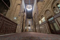 Interior of al Refai mosque with old decorated bricks stone wall, colored marble decorations, wooden ornate ceiling, Cairo, Egypt. Cairo, Egypt - December 16 Stock Photos