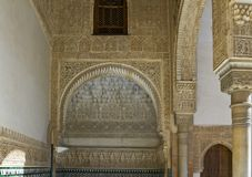Interior of Alhambra Granada: arabesques around a passageway. Semicircular festooned arch of Nasrid Palaces, Alhambra Granada, Spain Royalty Free Stock Photo