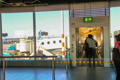 Interior of Amsterdam Airport Schiphol. Passengers are directed Stock Photo