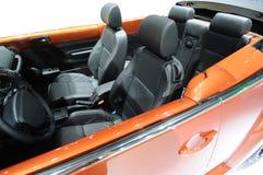 Interior anaranjado del coche Fotos de archivo