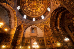 Interior of ancient armenian сathedral. ISFAHAN, IRAN: Interior of ancient armenian Vank Cathedral with frescoes of Jesus' life & vintage decor. Vank Cathedral Stock Photo