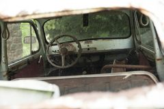 Interior of ancient car. Interior of an abandoned car. the glass is broken and rust can be seen stock photography