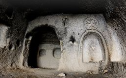 Interior of ancient cave christian temple with image of cross cut on the wall, Soganli ,Cappadocia, Turkey Stock Photo