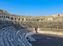 Ancient Roman Arena in France with Blue Sky. Interior of ancient Roman arena in the south of France against a clear blue sky Stock Photo