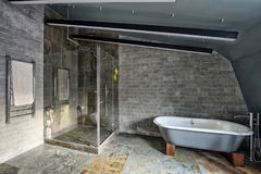 Bathroom at home in loft style with designer renovation. Royalty Free Stock Image