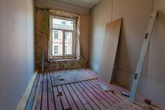 Interior of apartment with materials during on the remodeling, renovation, extension, restoration, reconstruction and construction. Upgrading wall from gypsum Stock Photography