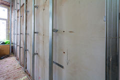 Interior of apartment with materials during on the renovation and construction. Making wall from drywall Stock Images