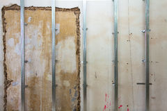 Interior of apartment with materials during on the renovation and construction. Making wall from drywall Royalty Free Stock Photos
