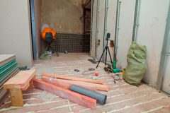 Interior of apartment with materials during on the renovation and construction. Making wall from drywall Royalty Free Stock Photo