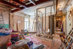 Interior of apartment with materials during on the renovation and construction. Remodel wall from gypsum plasterboard or drywall Royalty Free Stock Image