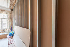 Interior of apartment with materials during on the renovation and construction. Remodel wall from gypsum plasterboard or drywall Stock Image