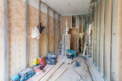 Interior of apartment with materials during on the renovation and construction. Remodel wall from gypsum plasterboard or drywall Royalty Free Stock Images