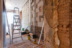 Interior of apartment with materials during on the renovation  making wall from gypsum plasterboard. Interior of apartment with materials during on the Royalty Free Stock Photo
