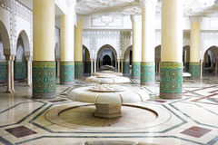 Interior arches and mosaic tile work in Hassan II Mosque in Casablanca, Morocco. Interior arches and mosaic tile work of hammam turkish bath in Hassan II Mosque Royalty Free Stock Photography