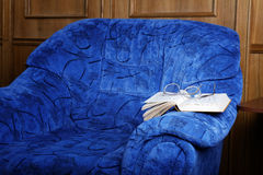 Interior with an armchair and the  book Royalty Free Stock Photos