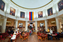 Interior of the Armenia pavilion in VDNKh park, people have drinks. Stock Image