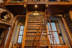 Interior of Austrian National Library. Vienna, Austria - December 24, 2017. Interior of Austrian National Library with wooden ladder and bookshelves. Hapsburg royalty free stock photos