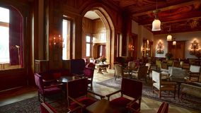 Interior of Badrutt Palace Hotel St. Moritz Switzerland. Time lapse pan to right of the interior of the Badrutt Palace Hotel in St. Moritz Switzerland stock video footage