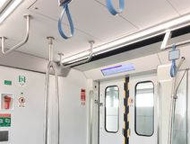 Interior of Bangkok subway train at the opening door. Interior of Bangkok subway train at the opening door shown safety sign and position of hanging steel bar Stock Images