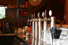 Interior bar. Some beer filling machines inside a bar. a kind of urban lifestyle's background Stock Photo