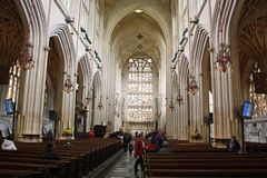 Interior of Bath Abbey. View to  the altar at the eastern end of the nave.  Abbey architecture differs with low aisles and nave arcades and the very tall Royalty Free Stock Photos