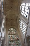Interior of Bath Abbey. View to ceiling over the altar at the eastern end of the nave.  Abbey architecture differs with low aisles and nave arcades and the very Royalty Free Stock Images