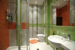 Interior of a bathroom. In green and orange colors Stock Image