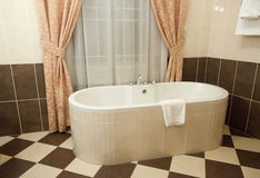 Interior of bathroom. With  bathtub Royalty Free Stock Image
