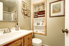 Interior of bathroom with built-in shelves Stock Photography