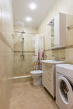 Interior of a bathroom, combined toilet and shower Royalty Free Stock Photo