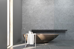 Interior of a bathroom with a narrow window, wooden tub, concrete walls and a long shelf. Royalty Free Stock Images