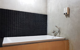 Interior of bathroom with sink basin faucet and mirror. Royalty Free Stock Image