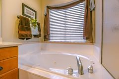 Interior of bathroom with sparkling clean bathtub royalty free stock images