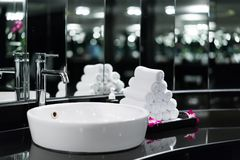 Interior of bathroom with washbasin faucet and white towel in ho stock photos
