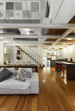 Interior, beautiful loft. Architecture, wide loft with modern furniture, living room Stock Photography