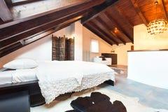 Interior, beautiful loft. Luxurious bedroom Royalty Free Stock Photography