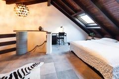 Interior, beautiful loft. Luxurious bedroom Royalty Free Stock Photos