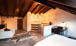 Interior, beautiful loft. Luxurious bedroom Royalty Free Stock Photo