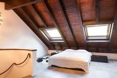 Interior, beautiful loft. Luxurious bedroom Stock Image