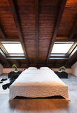 Interior, beautiful loft. Luxurious bedroom Stock Photos