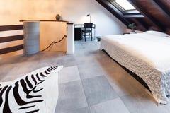 Interior, beautiful loft. Luxurious bedroom Stock Photography