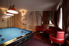 Interior of beautiful and modern billiard. Brand new and modern billiard interior in night time Stock Photography