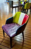 Interior. beautiful multi-colored chair from scraps of green, white, black, red, purple Stock Photos