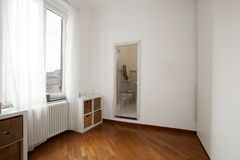 Interior apartment. empty white wall. Interior beauty apartment. White empty romm with elegant dark parquet stock image